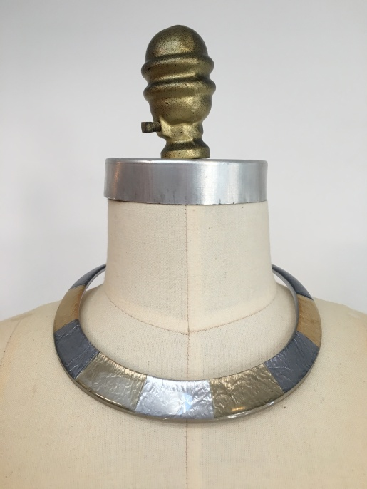 silver and gold neck cuff